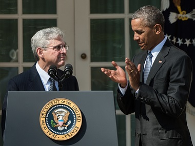 US President Barack Obama applauds his Supreme Court justice nominee Merrick Garland in the Rose Garden at the White House in Washington, DC. AFP