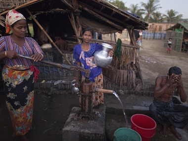 Rohingya women and men gather at the Thel-Chaung displacement camp in Rakhine State. File photo. AFP