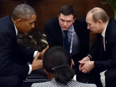 File photo of Barack Obama and Vladimir Putin. AFP