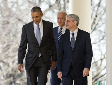 US President Barack Obama with Merrick Garland and vice-president Joe Biden at the White House. AP