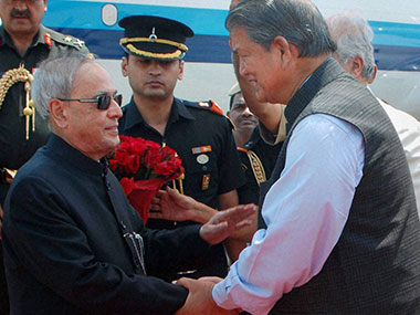 A file photo of Uttarakhand CM Harish Rawat and President Pranab Mukherjee. PTI