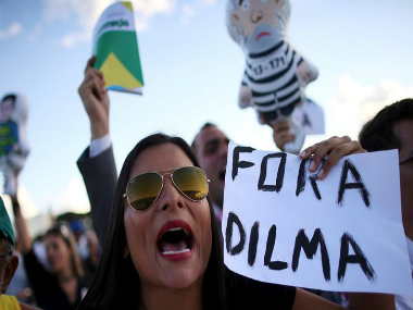 An anti-government demonstrator shouts slogans against Brazil's President Dilma Rousseff, during a protest against the appointment of former President Luiz Inacio Lula da Silva as a minister. Reuters