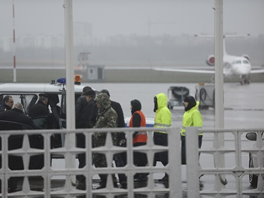 Russian Emergency Situations Ministry employees and police officers are seen as they take a car to drive to the area of the plane crash at the Rostov-on-Don airport. AP