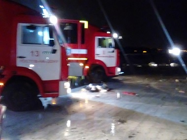 In this photo provided by Russian Emergency Situations Ministry, Russian emergency trucks are seen near the area of the plane crash at the Rostov-on-Don airport. AP