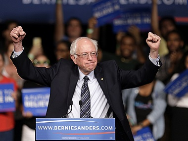 Democratic presidential candidate, Senator Bernie Sanders acknowledges his supporters on arrival at a campaign rally on Tuesday. AP