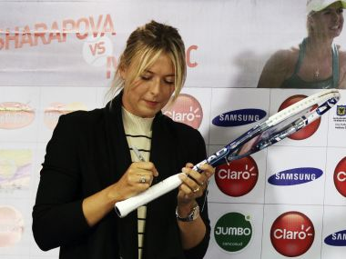 File photo of Maria Sharapova autographing a Head racket. Reuters