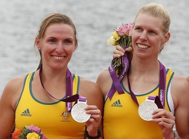 Australia's silver medalists Kate Hornsey (L) and Sarah Tait stand during the victory ceremony after the women's pair finals at Eton Dorney during the London 2012 Olympic Games. Reuters