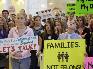Polygamy advocates protest laws making polygamy a felony in Utah. AP