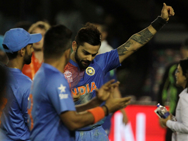 Virat Kohli savours India's the win with teammates in Mohali on Sunday. Solaris Images