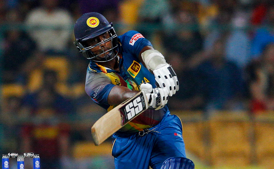 Sri Lanka's captain Angelo Mathews plays a shot during their ICC World Twenty20 2016 cricket match against West Indies' in Bangalore, India, Sunday, March 20, 2016. (AP Photo/Aijaz Rahi)