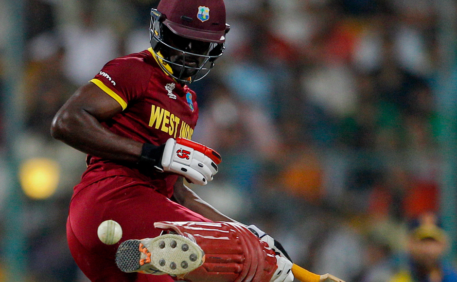 West Indies' Andre Fletcher kicks away the ball to avoid getting out during their ICC World Twenty20 2016 cricket match against Sri Lanka in Bangalore, India, Sunday, March 20, 2016. (AP Photo/Aijaz Rahi)
