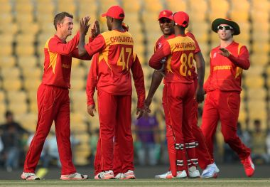 Zimbabwe celebrate during WT20 qualifier against Scotland. AFP