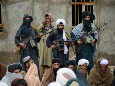 Afghan Taliban fighters listen to Mullah Mohammed Rasool, the newly-elected leader of a breakaway faction of the Taliban, in Farah province, Afghanistan. AP