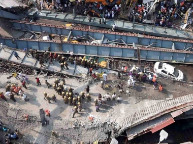 Rescue work in progress as an under-construction flyover collapsed on Vivekananda Road in Kolkata on Thursday. PTI