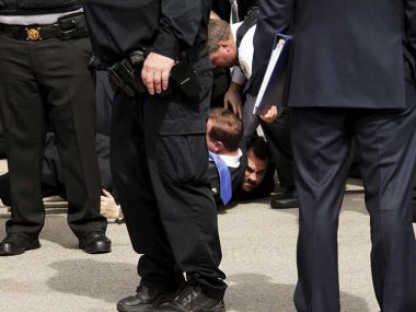 US Secret Service agents detain another man at US Republican presidential candidate Donald Trump's speech at Dayton International Airport in Ohio. Reuters