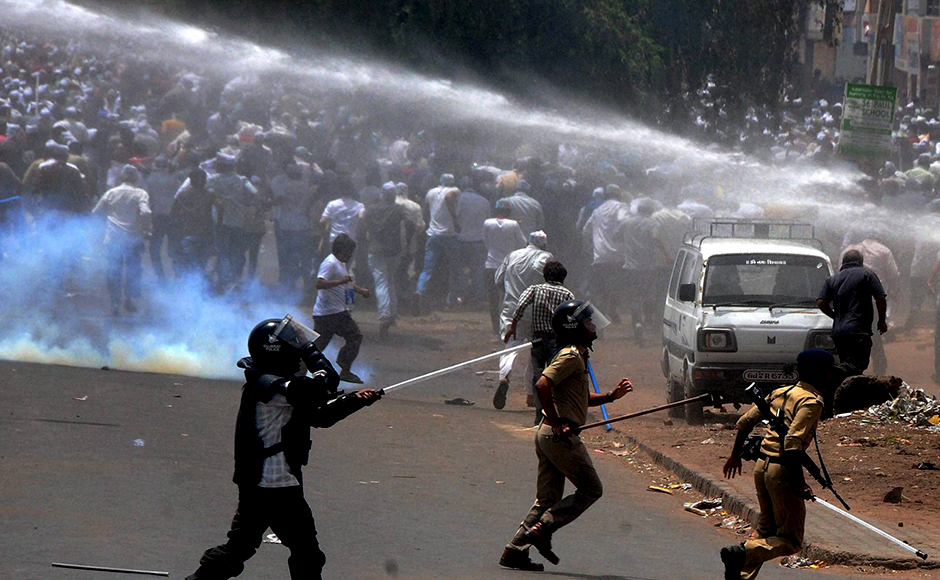 """Police use water canon to control members of Patidar community during their """"Jail Bharo Andolan"""" for demanding release of Hardik Patel in Mahesana on Sunday. PTI Photo"""
