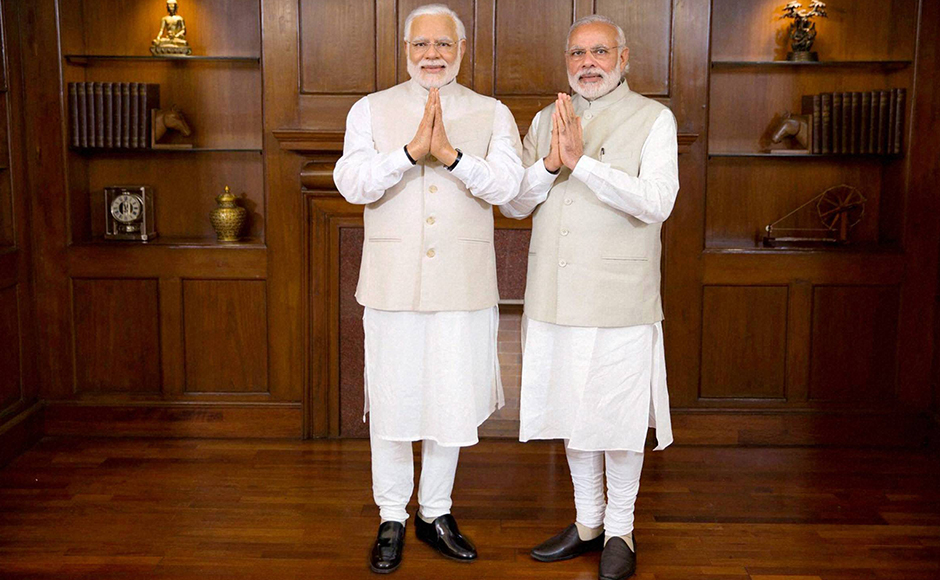 Prime Minster Narendra Modi poses with his wax statue due to be placed at London's Madame Tussauds museum, in New Delhi. Three of his wax statues have been installed in Singapore, Hong Kong and Bangkok and one of them will be put up in London in the next eight days. PTI Photo / Madame Tussauds