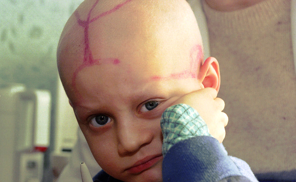 FILE In this file photo taken on Wednesday, March 19, 1996, five-year-old Alek Zhloba, who suffers from leukaemia, is held by his doctor in the children's cancer ward of the Gomel Regional Hospital, in Gomel, Belarus. There are tracks from medical procedures on his head. Much of the nuclear fallout from the 1986 Chernobyl disaster fell on Belarus. Thirty years ago, the Chernobyl Nuclear Power Plant exploded in Ukraine, spreading radioactive material across much of the Northern Hemisphere. The Chernobyl nuclear power plant explosion was only about 60 miles from photographer Efrem Lukatsky's home, but he didn't learn about it until the next morning from a neighbor. Only a few photographers were allowed to cover the destroyed reactor and desperate cleanup efforts, and all of them paid for it with their health. I went a few months later, and have returned dozens of times. (AP Photo/Efrem Lukatsky File)