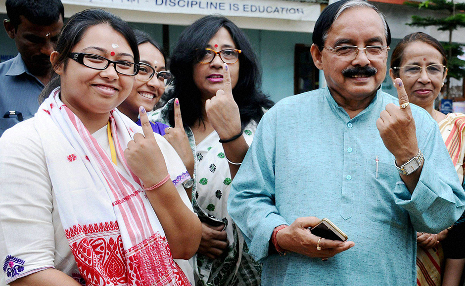Amguri: Assam Pradesh Congress Committee president Anjan Dutta along with his daughter and congress candidate from Amguri LAC Angkita Dutta and other family members after casting their votes in Amguri on Monday. PTI Photo