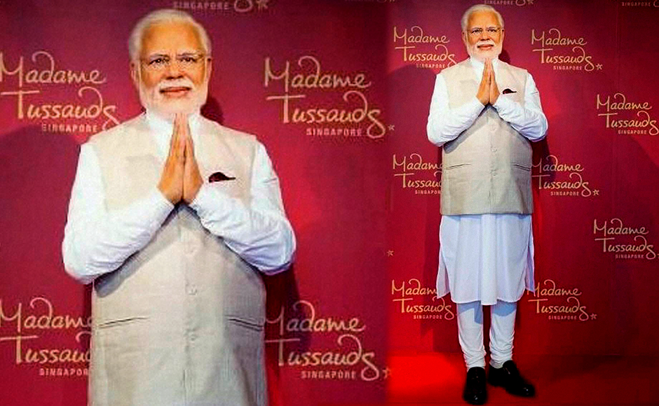 Prime Minster Narendra Modi's wax statue installed at Singapore's Madame Tussauds museum on Wednesday. Three of his wax statues have been installed in Singapore, Hong Kong and Bangkok and one of them will be put up in London in the next eight days. PTI Photo / Madame Tussauds museum