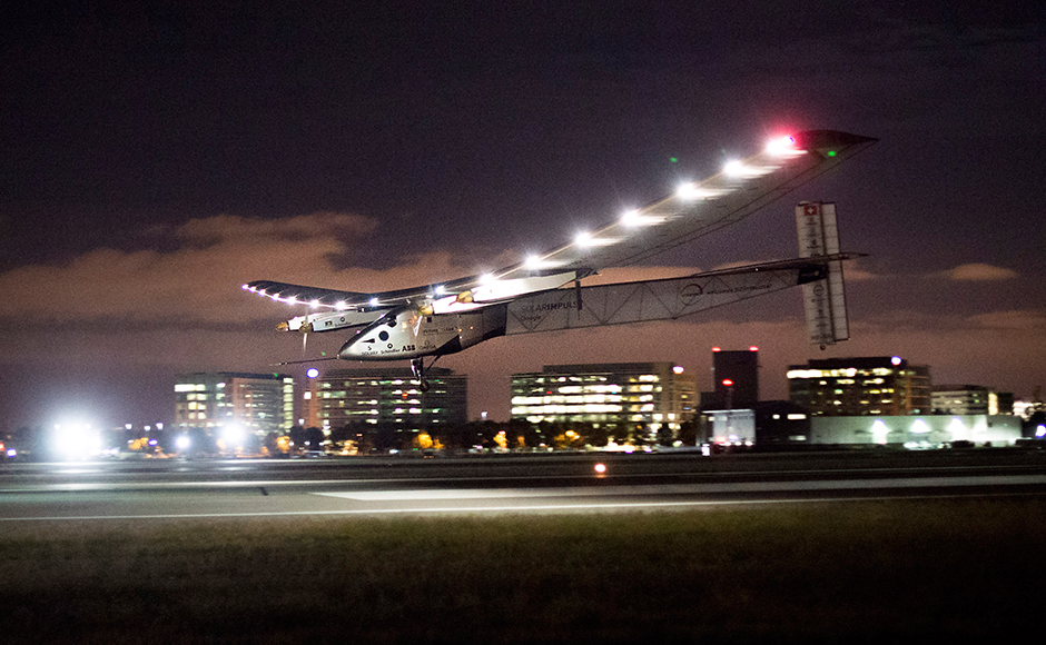 Solar Impulse 2 lands at Moffett Field in Mountain View, Calif., after crossing the Pacific Ocean on Saturday, April 23, 2016. The solar-powered airplane landed in California on Saturday, completing a risky, three-day flight across the Pacific Ocean as part of its journey around the world. (AP Photo/Noah Berger)