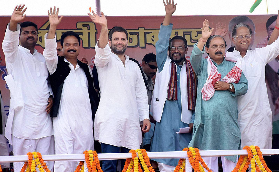 Congress Vice President Rahul Gandhi waves hand with other party leaders and candidates during an election rally in Lathima, Assam on Monday. PTI Photo