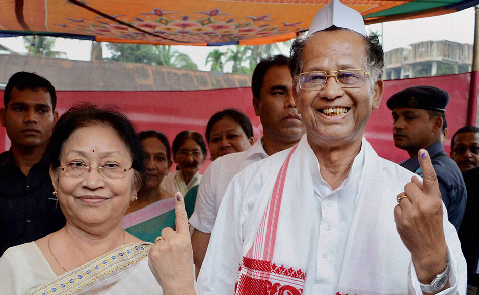Jorhat: Assam Chief Minister Tarun Gogoi with his wife Dolly Gogoi showing their mark after casting vote for the first phase of Assam Assembly election, at Jorhat district of Assam on Monday. PTI Photo