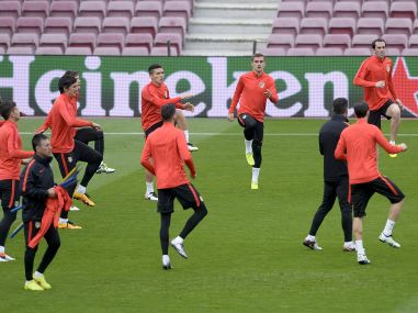 Atletico Madrid's players practice during a training session at the Camp Nou stadium in Barcelona. AFP