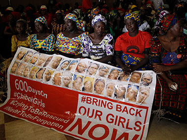 "Parents of the Chibok girls hold a ""Bring Back Our Girls"" banner during their meeting with Nigeria's President Muhammadu Buhari in January. Reuters"