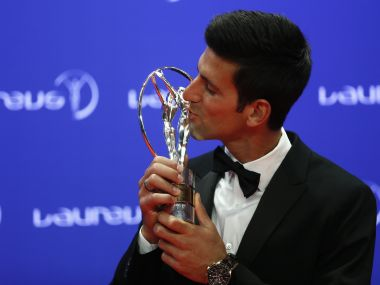 Novak Djokovic with his Laureus World Sportsman of the Year award. Reuters