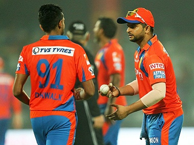 Gujarat Lions captain Suresh Raina (right) with Dhawal Kulkarni. BCCI