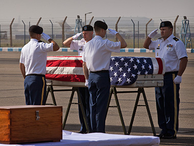 US military members pay final respects to what they believe may be the remains of one to two crew members from a B-24 bomber that crashed during World War II at a ceremony at the Palam airport in New Delhi on Wednesday. AP