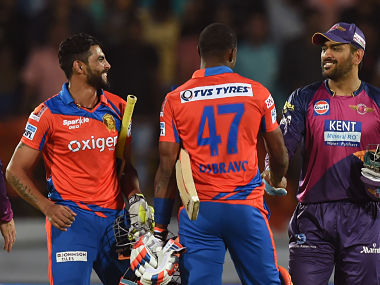 Gujarat Lions Ravindra Jadeja and Dwayne Bravo is congratulated by Rising Pune Supergiants captain Mahendra Singh Dhoni. AFP