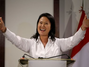 Presidential candidate Keiko Fujimori, daughter of jailed former President Alberto Fujimori, gives the thumbs up during a news conference, in Lima, Peru, Sunday, April 10, 2016.