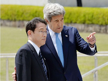 Japan's Foreign Minister Fumio Kishida, left, and US Secretary of State John Kerry talk after offering wreaths at the cenotaph at Hiroshima Peace Memorial Park on Monday. AP