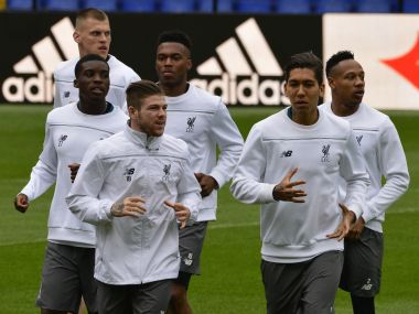 Liverpool's players run during a training session at the Madrigal Stadium in Villareal.