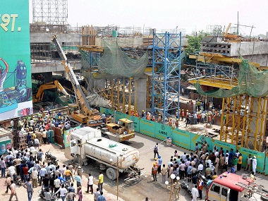 NDRF and  local authorities carry out relief operations after an under-construction bridge collapsed in Lucknow on Sunday. PTI
