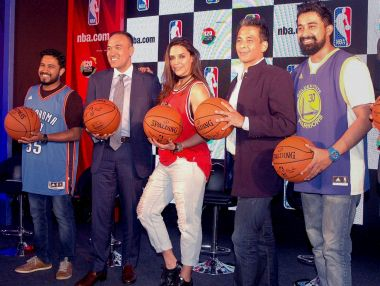 Bollywood actors Neha Dhupia and Rannvijay Singh during launch of the NBA's Digital Destination. PTI