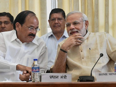 A file photo of Venkiah Naidu and Narendra Modi. PTI