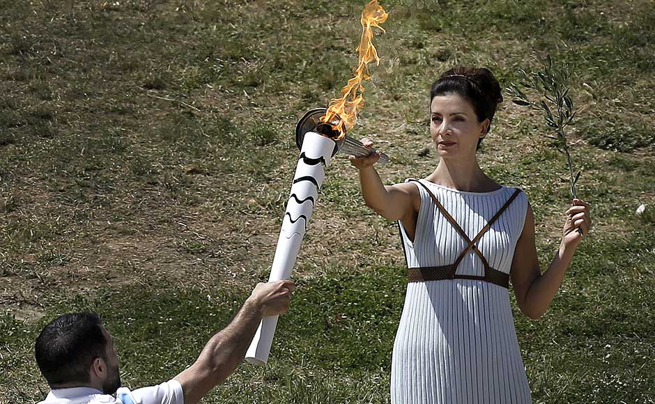 The dress rehearsal for the Olympic flame lighting ceremony for the Rio 2016 Olympic Games takes place at the site of ancient Olympia in Greece, April 20, 2016. REUTERS/Alkis Konstantinidis
