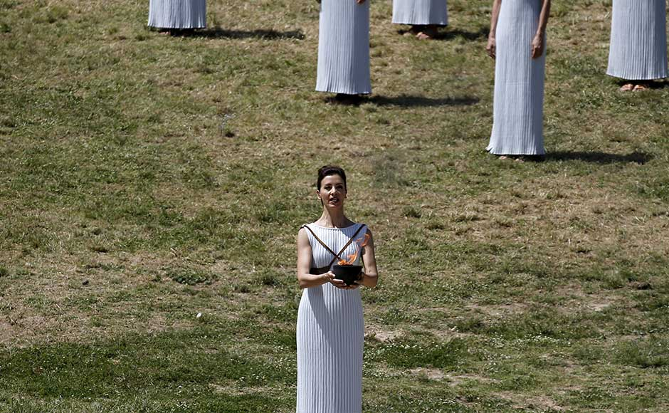 Greek actress Katerina Lehou, playing the role of High Priestess, carries the Olympic flame during the dress rehearsal for the Olympic flame lighting ceremony for the Rio 2016 Olympic Games at the site of ancient Olympia in Greece, April 20, 2016. REUTERS/Alkis Konstantinidis