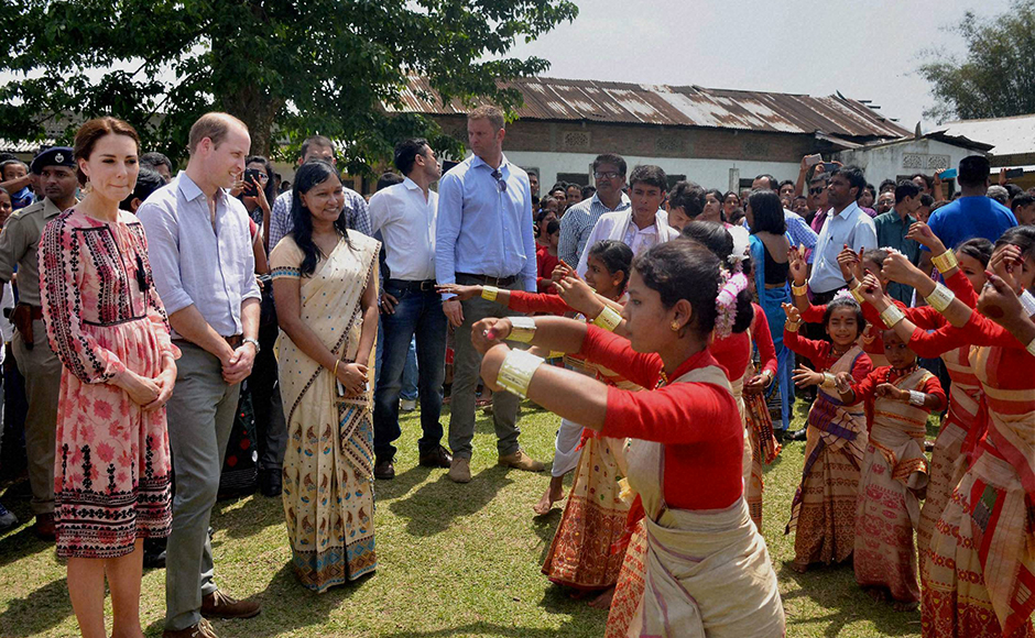 Prince William, Duke of Cambridge and his wife Catherine (Kate), Duchess of Cambridge being welcomed by village women during their visit to Panbari Model village near Kaziranga, Assam on Wednesday. PTI Photo