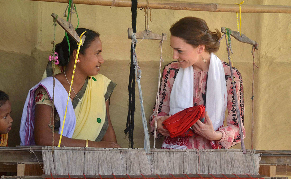 Catherine (Kate), Duchess of Cambridge gestures after receiving a traditional cloth as a gift from a woman weaver during a visit to Panbari Model village near Kaziranga, Assam on Wednesday. PTI Photo
