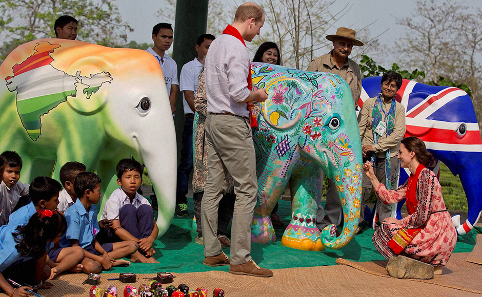 Kate, the Duchess of Cambridge gives a finishing touch of paint on a statue of elephant as Britain's Prince William looks on at the Centre for Wildlife Rehabilitation and Conservation (CWRC) at Panbari reserve forest in Kaziranga, Assam on Wednesday. PTI Photo