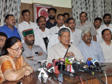 Deposed CN Harish Rawat addresses the media in Dehradun on Thursday after Uttarakhand HC set aside the imposition of President's rule in the state. PTI
