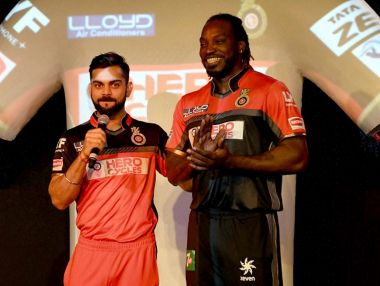 Royal Challengers Bangalore skipper Virat Kohli with teammate Chris Gayle. PTI