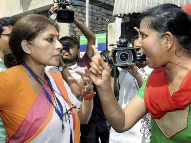 BJP candidate arguing with a TMC activist at a polling booth in Kolkata. PTI