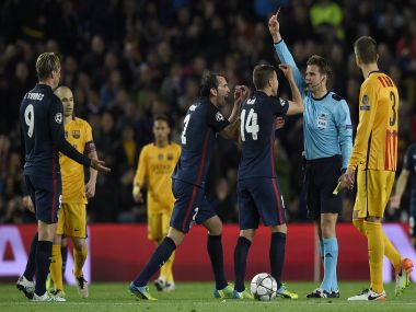 German referee Felix Brych shows a red card to Atletico Madrid's forward Fernando Torres. AFP