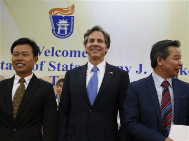US Deputy Secretary of State Antony Blinken, center, smiles with unidentified officials of Vietnam National University during his visit, in Hanoi, Vietnam. AP