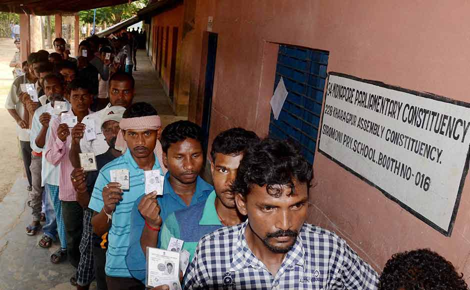 Voters wait in a long queue to cast votes at a polling booth during the state assembly elections in Kharagpur, West Bengal on Monday. PTI
